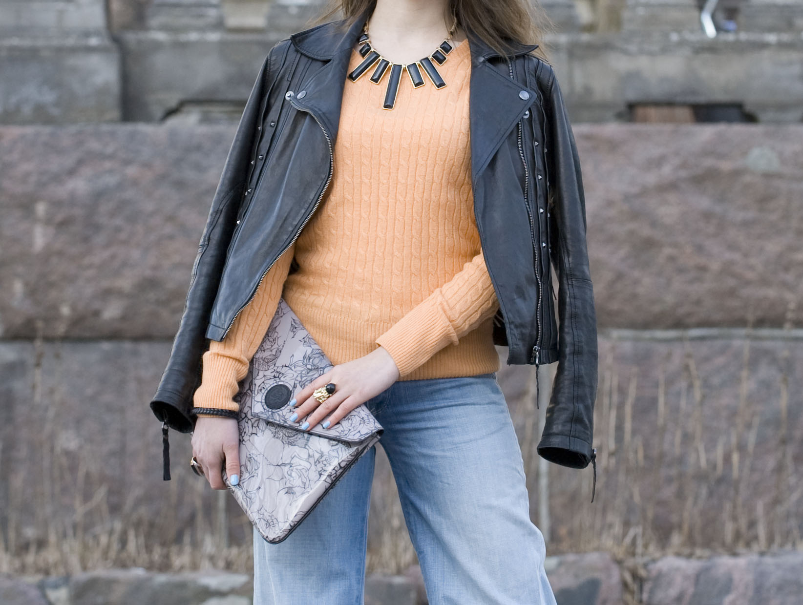 Orange cable knit sweater with denim