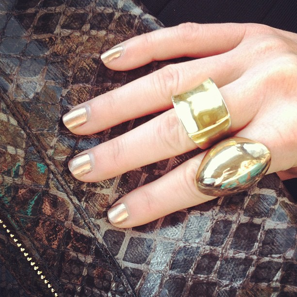 Metallic nails and gold rings